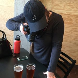 Katelyn Piziali taking pictures beers at Mustang Station