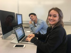 Trevor Melody and Rachel Furtado are all smiles while writing scripts for their videos