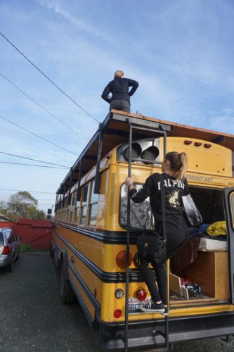 Clara Knapp and Allison Royal Climbing on Top of The Denali Bus