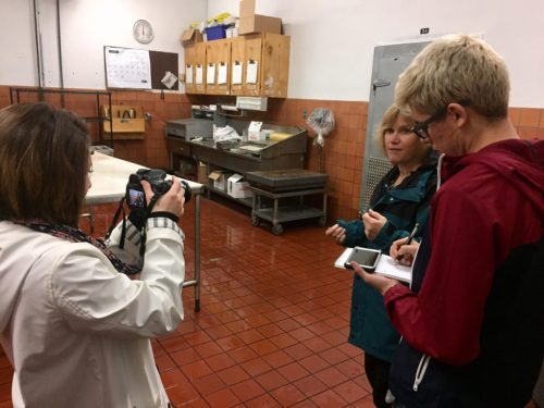 Peter and Gonzalez interviewing Ellen Curtis about how all of the fresh meat is prepared.