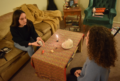 Knapp reads tarot cards for her roommate, anthropology and geology senior Audrey Cody - Photo by Dylan Ring