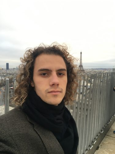 "No, that is not the actor from ""10 Things I Hate About You,"" that is me with a mane atop the Arc de Triomphe with the Eiffel Tower looming behind. Paris, France."
