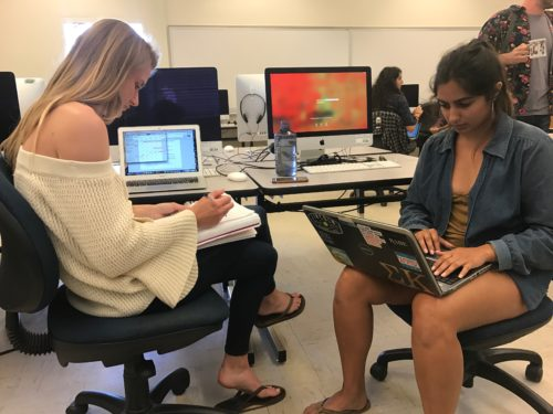 Journalism seniors Nicole Peterson and Mariam Alamshahi work on planning the story during class.