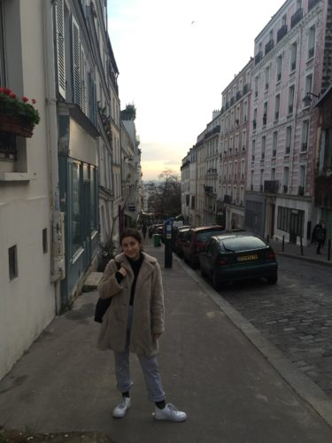 Levin stylishly stomping in the streets of Paris in the famed Montmarte district.