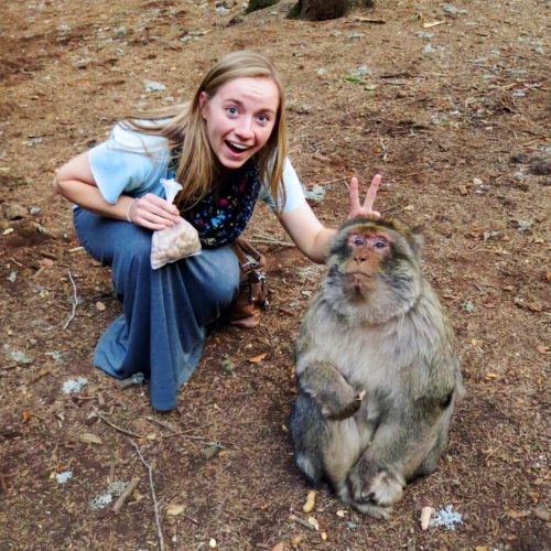 "Hoover pranks a monkey with the ""bunny-ears move"" while on a trip to Northern Africa. Cedre Gouraud Forest, Morocco."