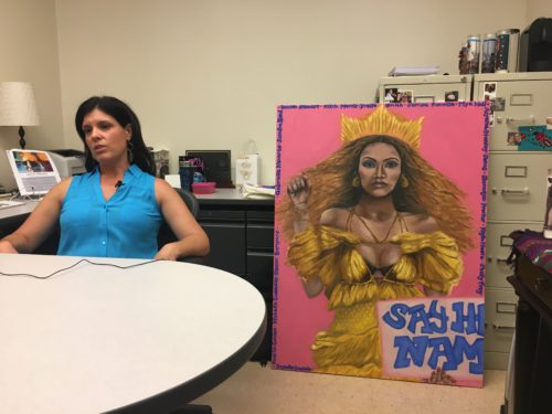 Dr. Navarro, and her hype woman Bey in Navarro's office.