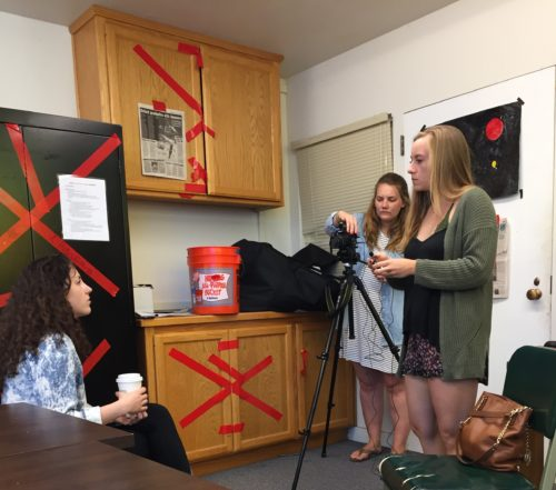 Amanda Newell and Laura Hoover prepare to interview Ciera Dixon in the student-run escape room.