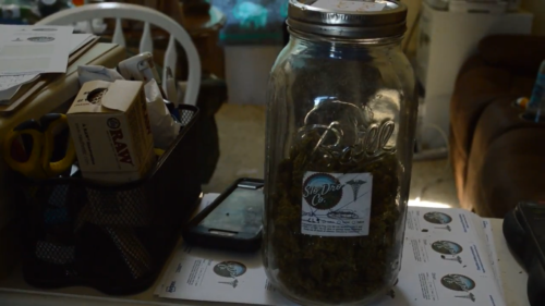 Jar of marijuana with the business lable, Slo Dro Co.
