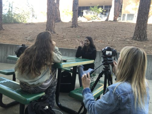 Reilly Roberts filming the interview with Dezeray Cruz