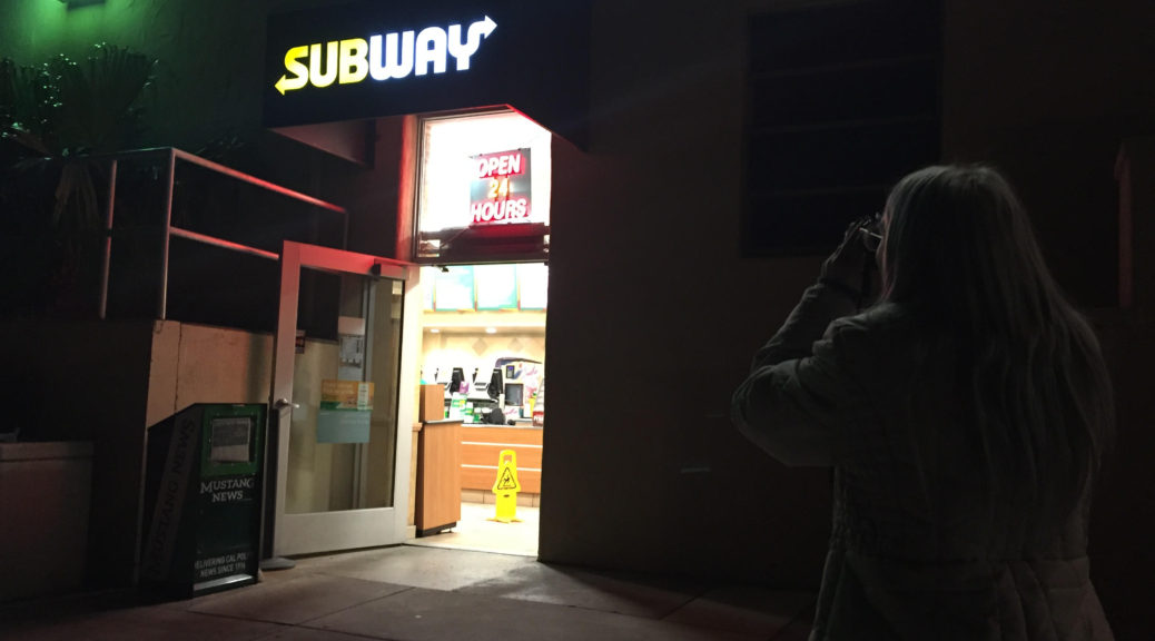 Shelby takes a picture of Cal Poly's Subway